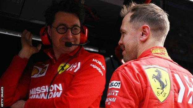 Ferrari team boss Mattia Binotto and Sebastian Vettel