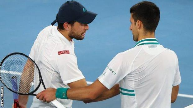 Aslan Karatsev and Novak Djokovic shake hands
