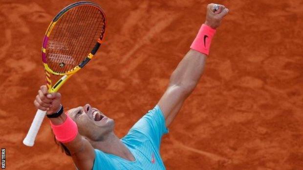 Rafael Nadal celebrates beating Diego Schwartzman in the French Open