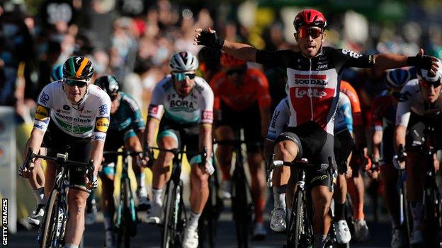 Australia's Caleb Ewan (right) puts his arms up in celebration after beating Ireland's Sam Bennett (left) in a bunch sprint on stage three of the 2020 Tour de France