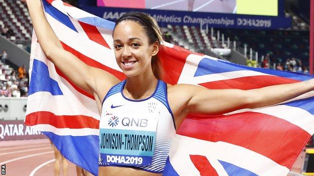 Katarina Johnson-Thompson celebrating with a British flag