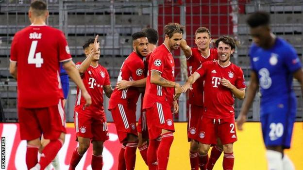 Bayern Munich's players celebrate scoring against Chelsea in the Champions League