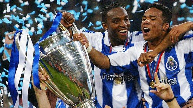 Benni McCarthy celebrates with the European Champions League trophy in 2004