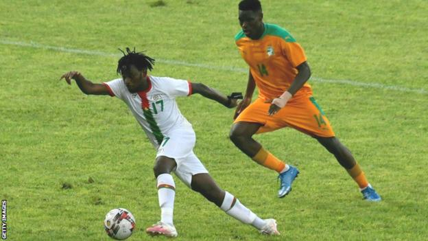 Torino's Wilfried Singo (right) in action for Ivory Coast against Zakaria Sanogo and Burkina Faso in June 2021