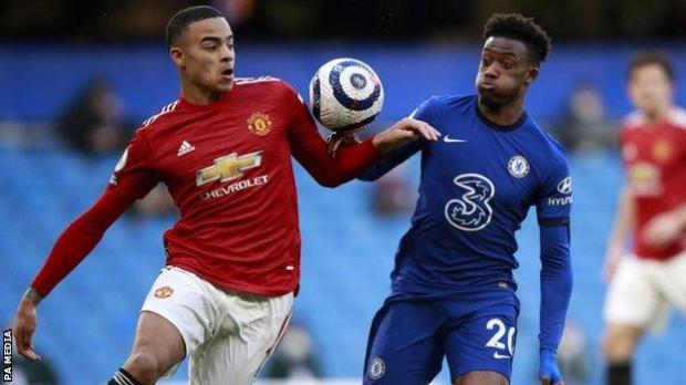Mason Greenwood and Callum Hudson-Odoi challenge for the ball