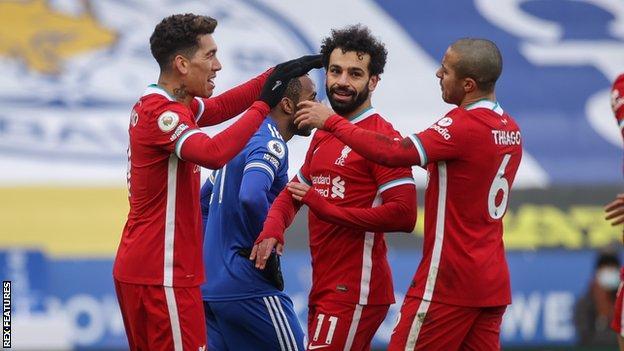 Liverpool forward Mohamed Salah (centre)