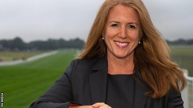 Delia Bushell stood on a racecourse