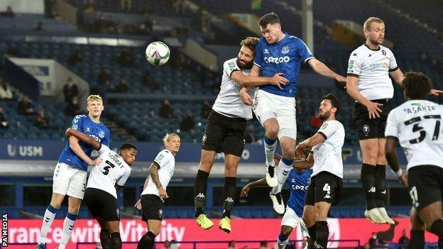 Michael Keane heads home a corner to give Everton the lead against Salford City