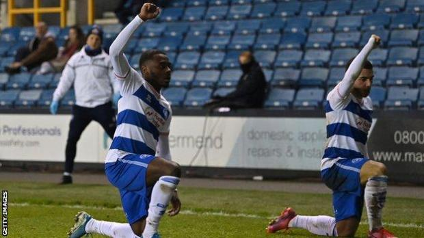 Bright Osayi-Samuel and QPR team-mate Ilias Chair celebrate Chair's goal against Millwall by taking a knee and raising a fist