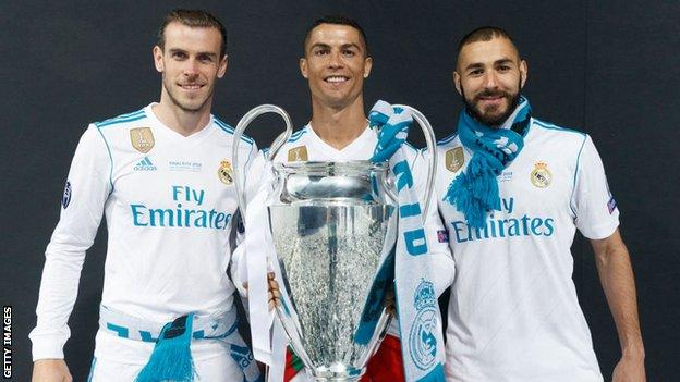 Gareth Bale, Cristiano Ronaldo and Karim Benzema pose with the 2018 Champions League trophy