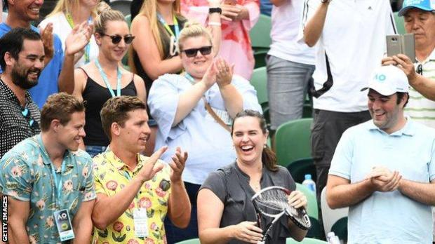 Woman in the crowd smiles as she is given Alexander Zverev's broken racquet at the 2019 Australian Open