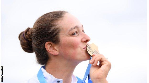 Mallory Franklin kisses a medal