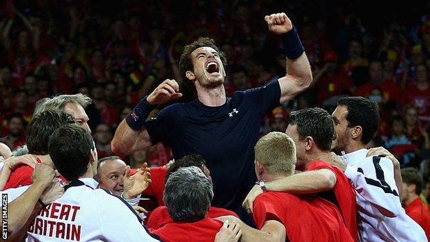 sport Andy Murray is hoisted into the air by his Great Britain team-mates