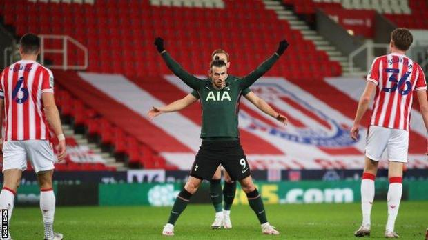 Gareth Bale celebrates after giving Tottenham the lead against Stoke City in the Carabao Cup