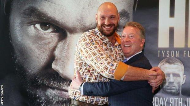 Tyson Fury hugs Frank Warren