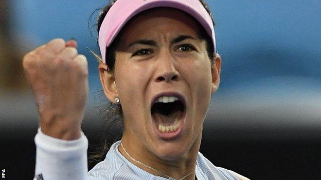 Garbine Muguruza celebrates beating Johanna Konta