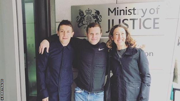 John McAvoy, pictured with Parkrun ambassador Andrew Graham and four-time world Ironman champion Chrissie Wellington outside the Ministry of Justice