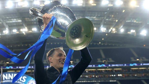 Thomas Tuchel lifting the Champions League trophy