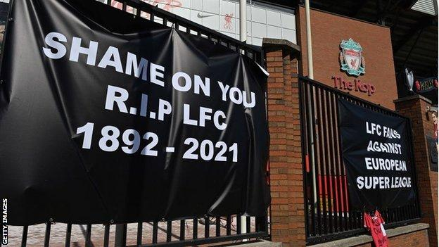 Protest banners outside Liverpool's Anfield stadium