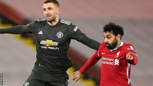 Manchester United's Luke Shaw (left) and Liverpool's Mohamed Salah