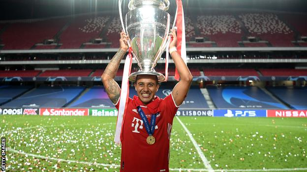 Thiago holds the Champions League trophy on his head