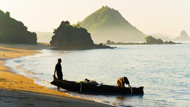 Fishermen returning to Kuta Beach with the daily catch in Lombok, Indonesia (Credit: Credit: Matthew Williams-Ellis/robertharding/Alamy)