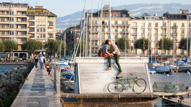 Couple Kissing on the Pier in Geneva, Switzerland (Credit: Credit: Kevin George/Alamy)