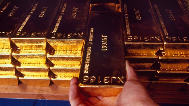 Stacks of gold bars are arranged on shelves in the Bank's vaults (Credit: Credit: David Levenson/Alamy)