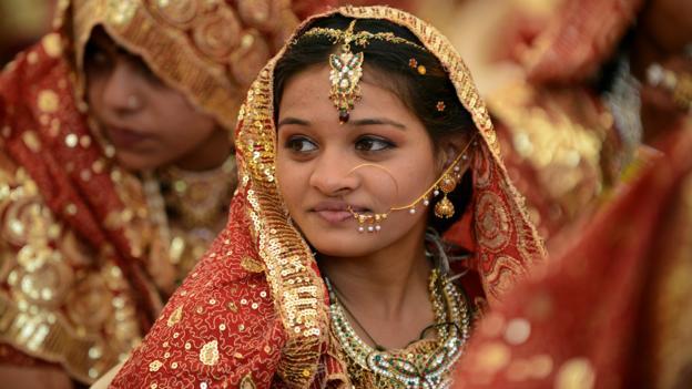 A bride in Ahmedabad, India (Credit: Credit: Sam Panthaky/AFP/Getty)