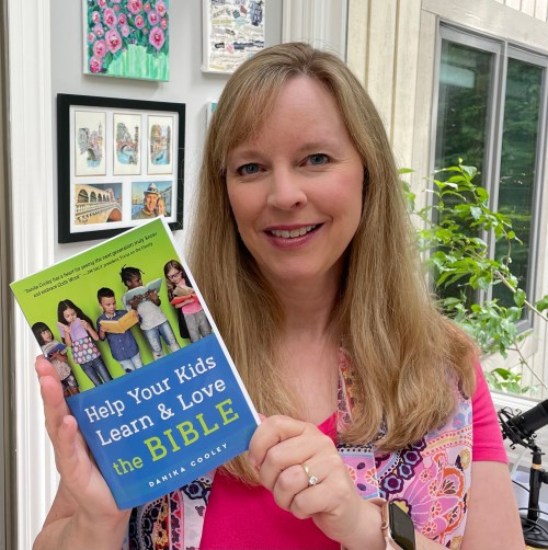 """Gena Mayo with the book """"Help Your Kids Learn & Love the Bible,"""" a book for all moms."""