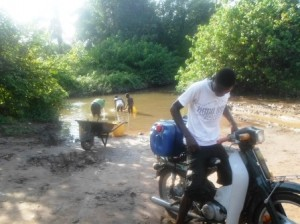 Villagers helping themselves from their only water source, Ideme River in Okpokwu LGA, Benue State