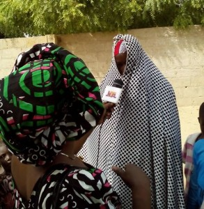 Maimuna the rape victim being interviewed by a TV crew