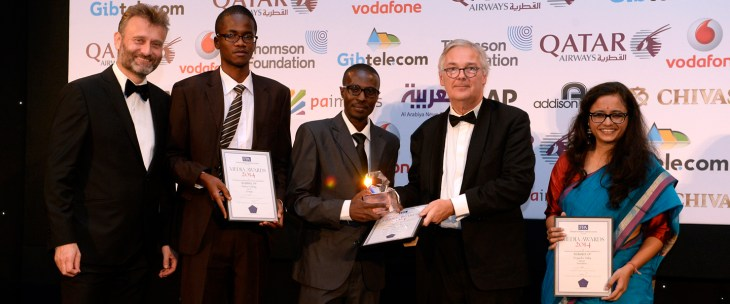 Viscount Chandos, Chairman of the Thomson Foundation (2nd right) presents the Thomson Foundation Award for the Best Young Journalist from the Developing World to Maurice Oniang'o (centre), where he was joined by runners up Priyanka Dubey (right) and Andrew Ochieng (2nd left) at the FPA Media Awards 2014 at the Park Lane Hotel, London