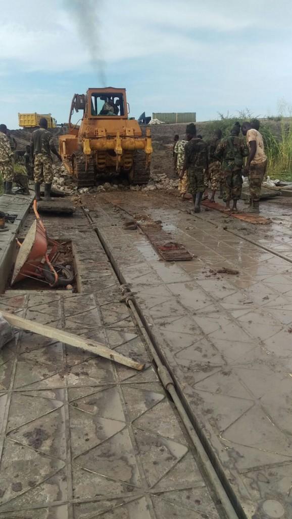 A team of Army engineers working on the bridge linking Maiduguri and Gamboru Ngala destroyed by Boko Haram insurgents