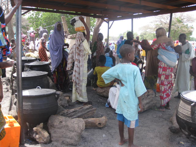 Children besiege the kitchen at Dalori Camp, Maiduguri