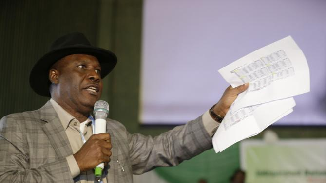 Godsday Orubebe,  People's Democratic Party agent, displays what he claims was the final result from the opposition party as he  disrupts the announcing of election results  accusing the Commission chairman Attahiru Jega, of beimg bias  in Abuja, Nigeria, Tuesday, March 31, 2015, Nigerians are waiting in hope and fear for results of the tightest and most bitterly contested presidential election in the nation's turbulent history. (AP Photo/Sunday Alamba)