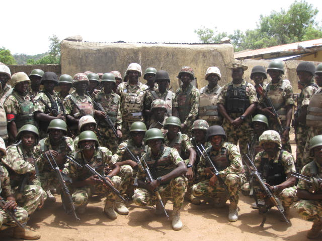 Brigadier General Ezugwu in a group photograph with troops in the front lines