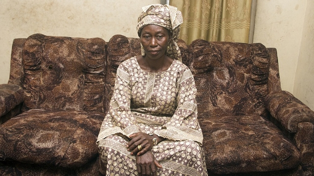 Mama Debo sits in the parlour of her family home [Hamed Adedeji/Al Jazeera]