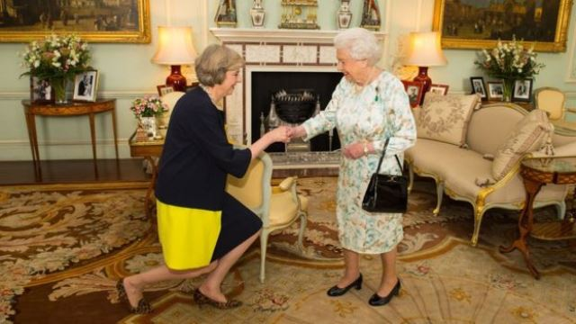 Theresa May greets Queen Elizabeth
