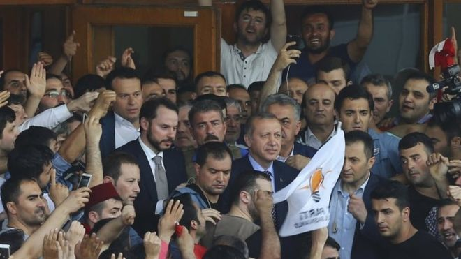President Erdogan (centre) welcomed by cheering supporters