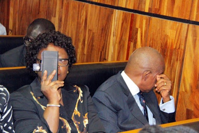 Justice Adeniyi Ademola and Wife trying to shield their faces from Journalists when they were arraigned in December 2016