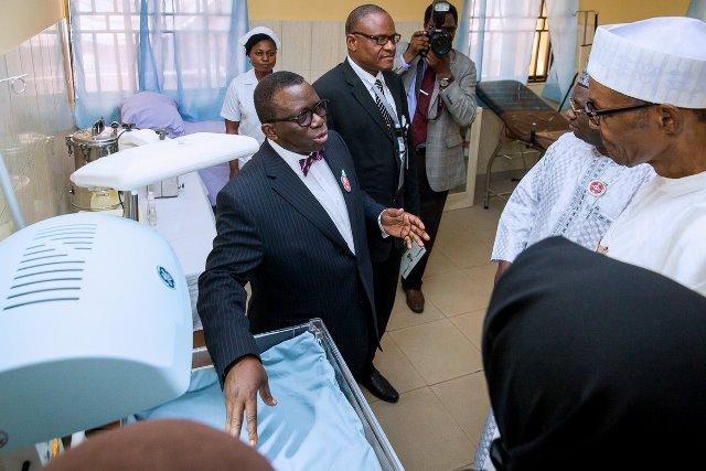 Health Minister Isaac Adewole shows President Buhari around the newly renovated Kuchigoro Primary Healthcare Centre