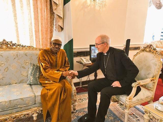 President Buhari greets Archbishop Welby at the Abuja House in London on Thursday
