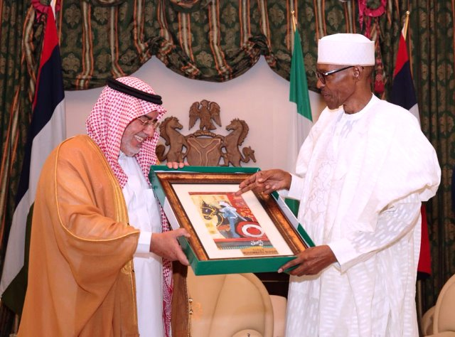 President Muhammadu Buhari presents the outgoing Saudi Arabian Ambassador, with a gift at the presidential villa in Abuja on Thursday