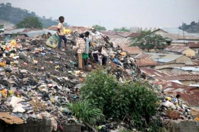 This mountain-sized dump site welcomes every visitor to Mpape, a hilly slum located of the expressway, Abuja