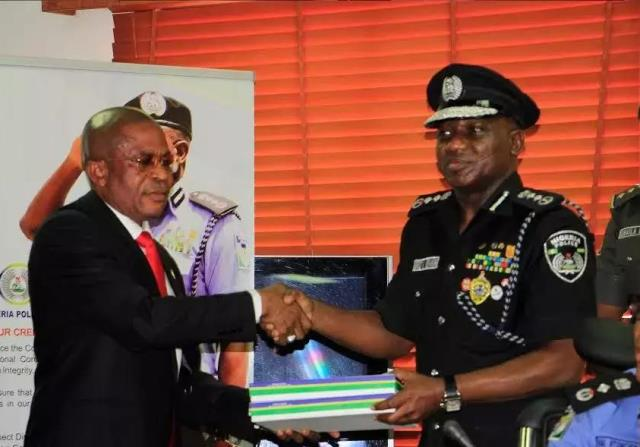 file: Chairman of the probe panel, DCP Damian Okoo, presenting the report to IGP Ibrahim Idris on February 7, 2017. Photo Credit: Sodiq Adelakun/Naij.com