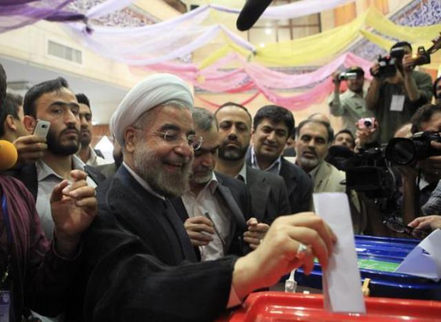Presidential candidate Hassan Rohani casts his ballot during the Iranian presidential election in Tehran on Friday. Photo Credit: Reuters/Livemint