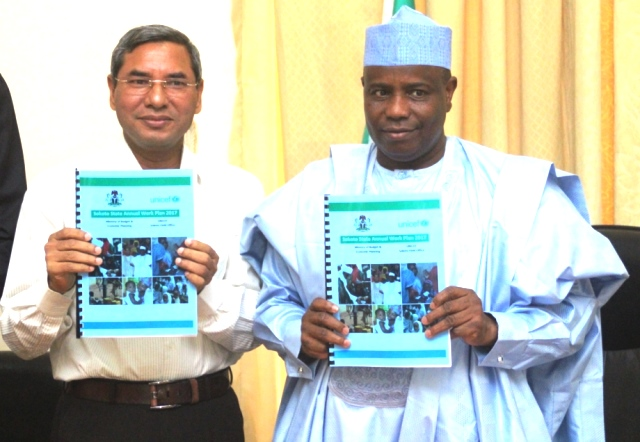 UNICEF's Chief Field Officer for Sokoto, Mohamed Muhuiddin and Governor Aminu Waziri Tambuwal, dispalying the 2017 work plan