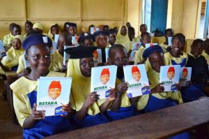 Some students displaying notebooks donated by Hon. Muktar Betara Aliyu