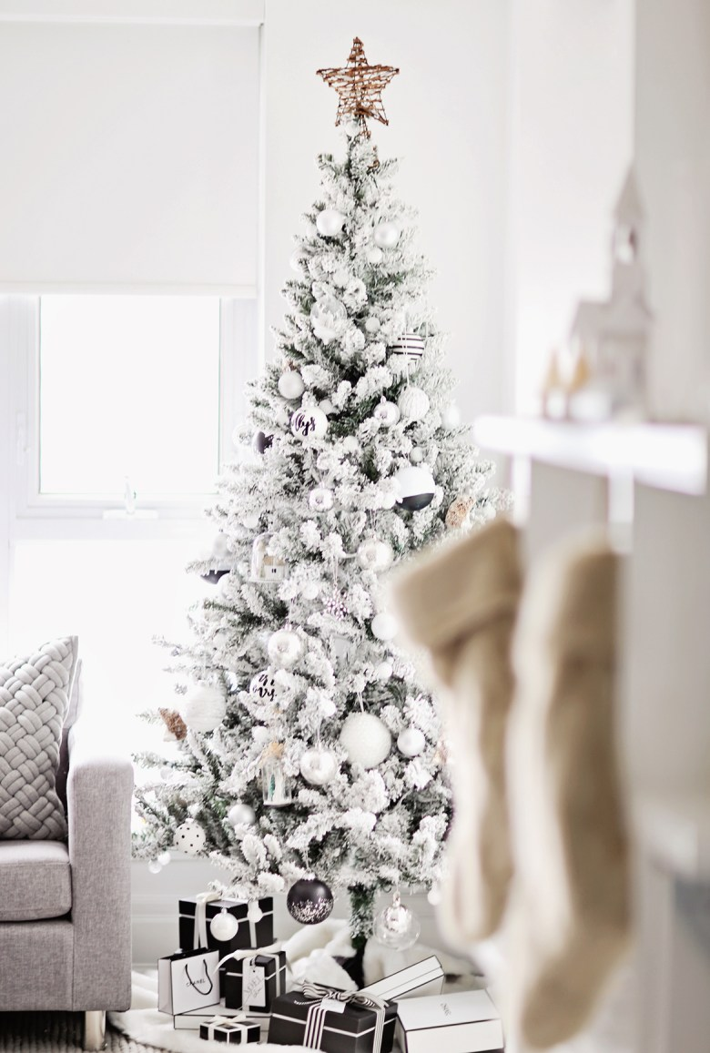Elegant Christmas tree with black and white decorations
